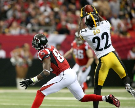 Dec 14, 2014; Atlanta, GA, USA; Pittsburgh Steelers cornerback William Gay (22) makes an interception in front of Atlanta Falcons wide receiver Harry Douglas (83) in the second quarter of their game at the Georgia Dome. Gay returned the interception for a touchdown. Mandatory Credit: Jason Getz-USA TODAY Sports